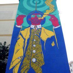 Il graffito di El Rughi raffigurante un rabdomante sulla cabina Enel di Martina Franca